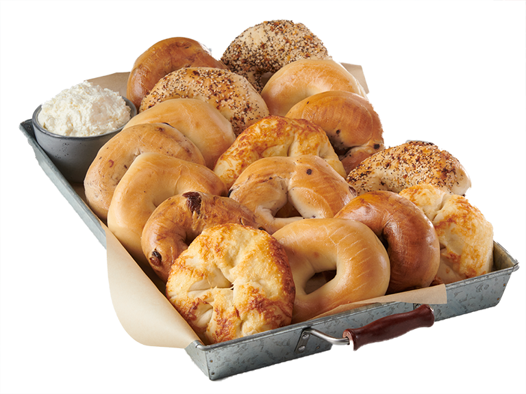 Assorted bagels with cream cheese on a metal serving tray