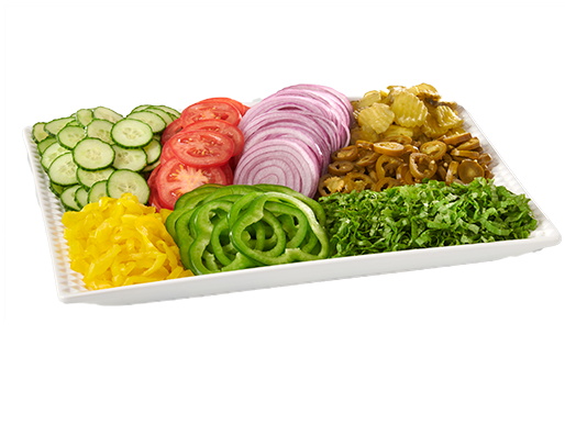 An assortment of cut vegetables for sandwiches on a white plate