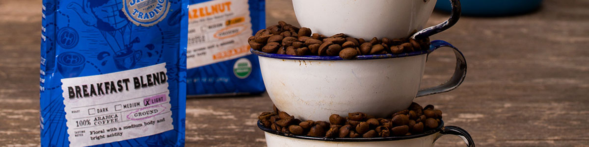 Java Trading Coffee bags with coffee beans filling coffee cups