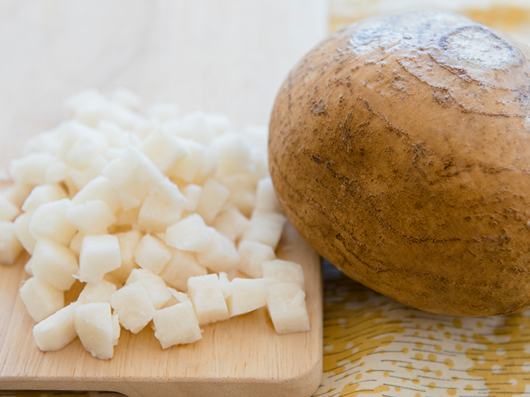 Jicama chopped on cutting board