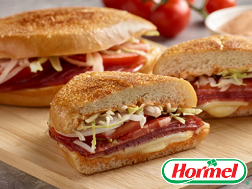 Sandwich made with hard salami muenster cheese cabbage onion and tomato