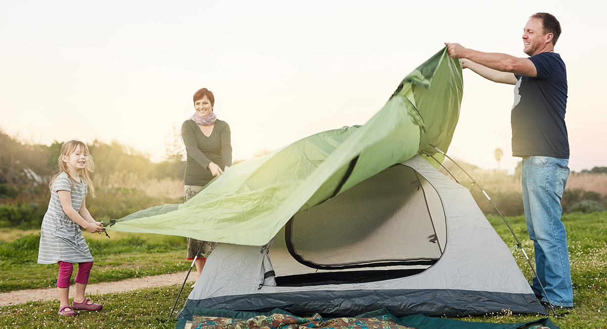 Setting up tent in backyard