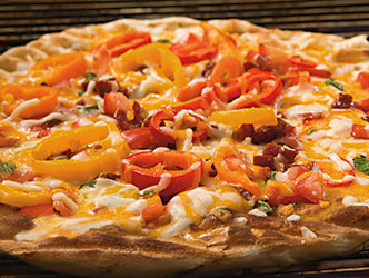 Grilled Spanish flatbread with cheese chorizo and vegetables