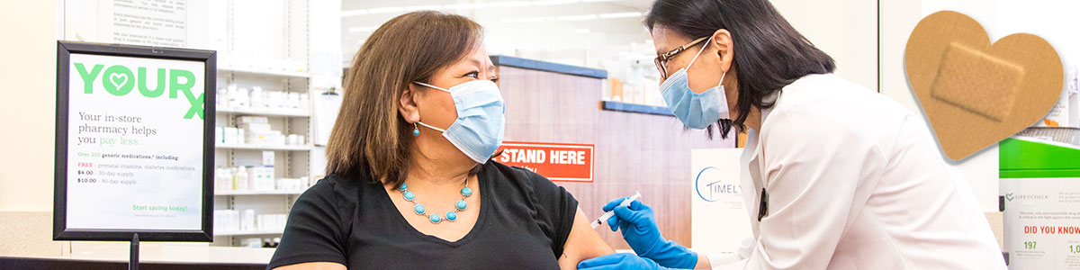 woman receiving covid 19 vaccination from pharmacist